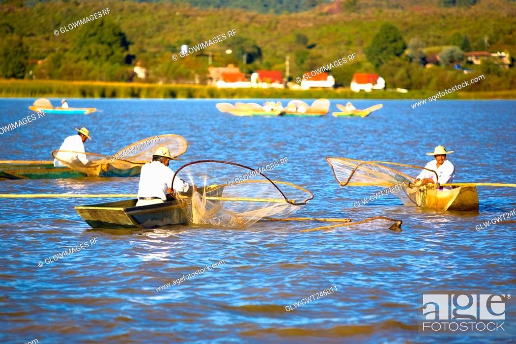 Stock Photo: Fishermen fishing in a lake, Lake Patzcuaro, Patzcuaro, Michoacan State, Mexico.