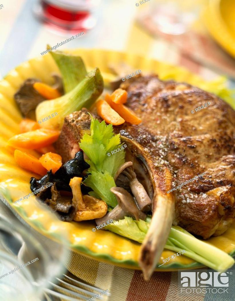 Stock Photo: Veal chop à la forestiere.