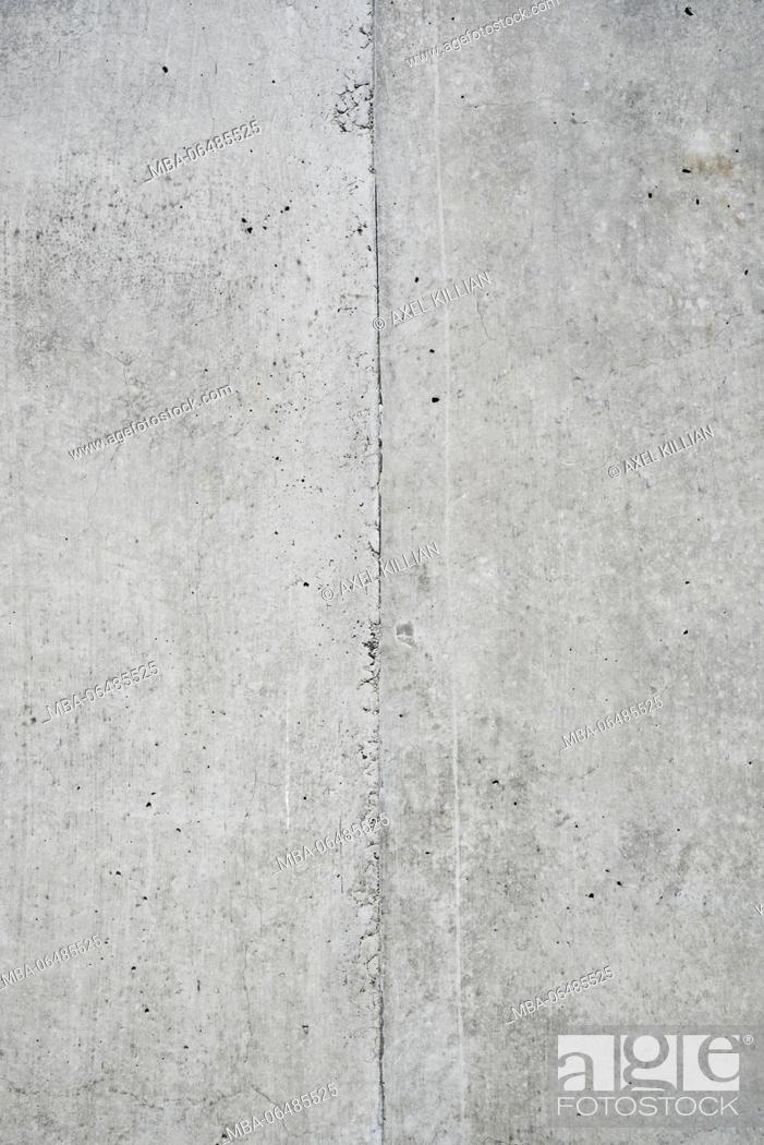 Stock Photo: Concrete grey wall with structure and inclusions as a background.