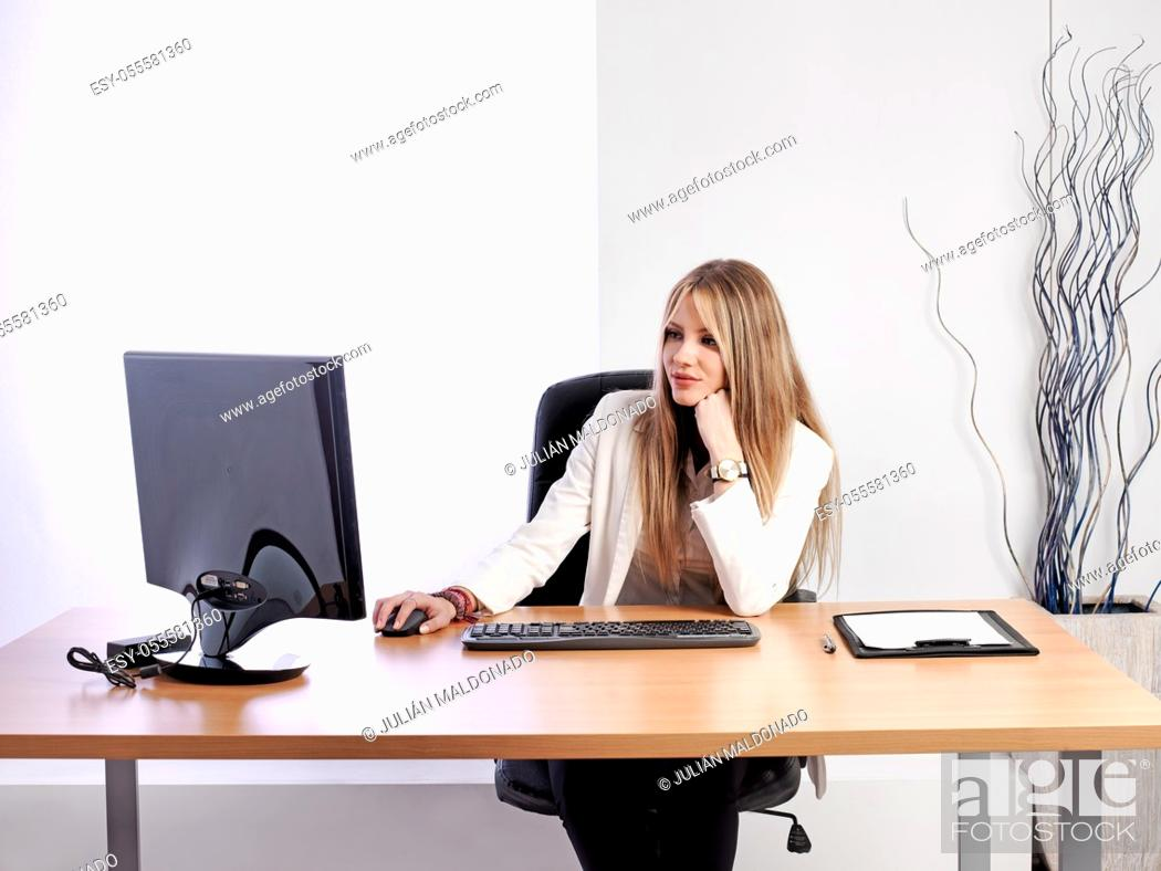 Stock Photo: Young business woman at her workplace.