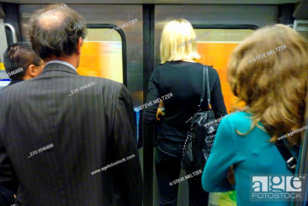 Stock Photo: People waiting to exit at their station.