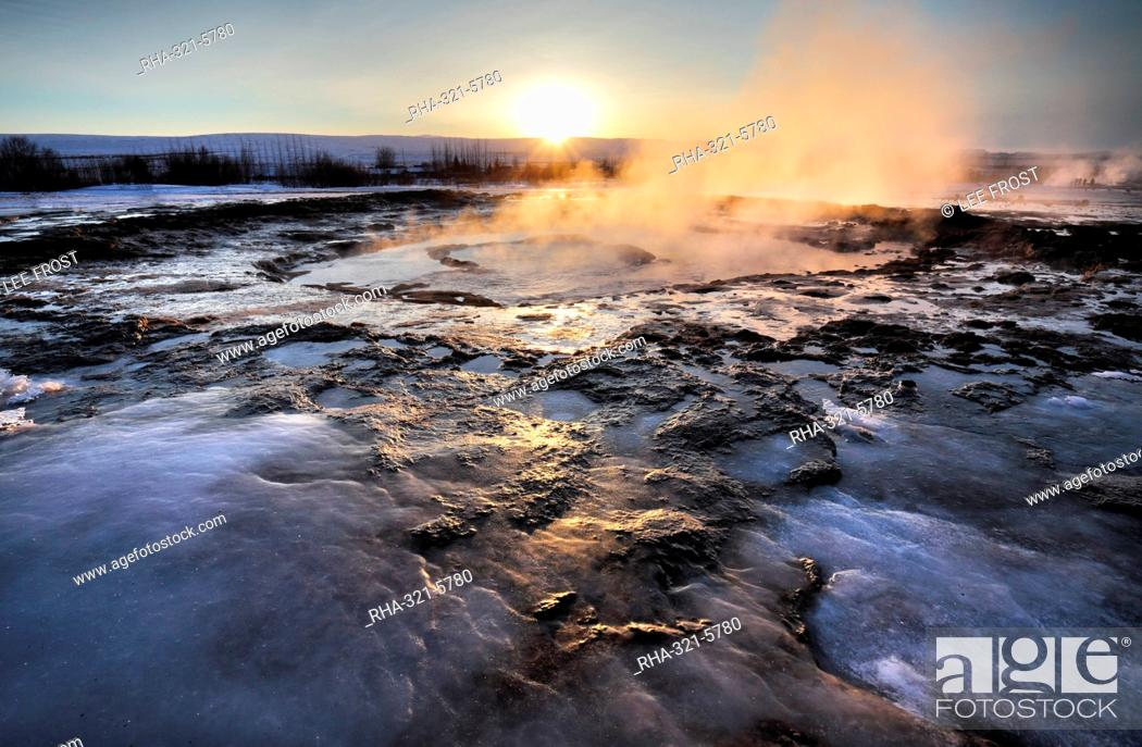 Stock Photo: Hot pools and steam from Strokkur Geysir at sunrise, winter, at geothermal area beside the Hvita River, Geysir, Iceland, Polar Regions.