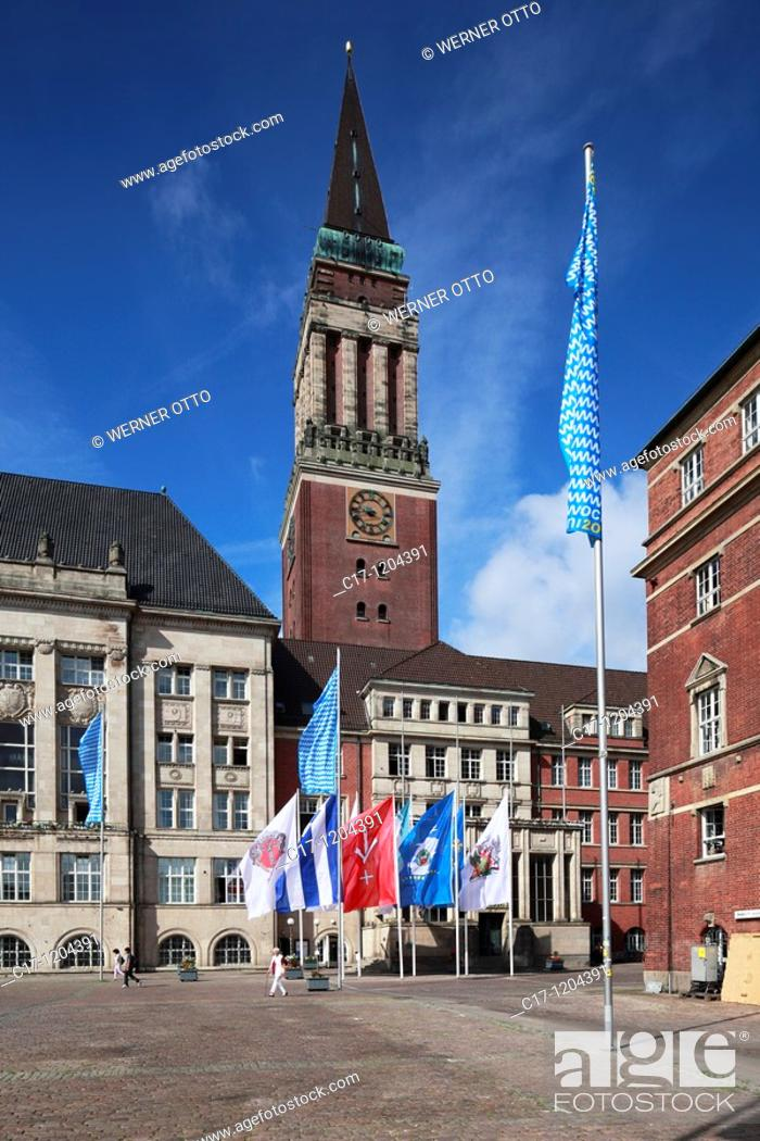 Stock Photo: Germany, Kiel, Kiel Fjord, Baltic Sea, Schleswig-Holstein, city hall, city hall tower, campanile, brick building, Rathaus Square, flags.