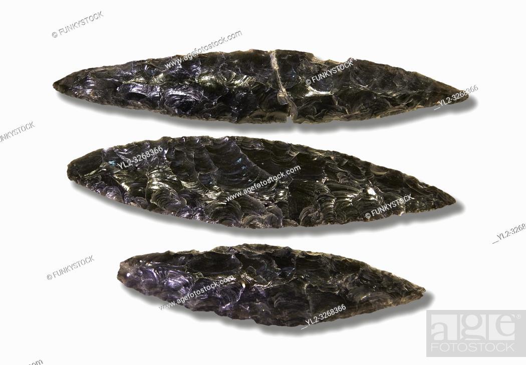 Photo de stock: Black obsidian blades. Catalhoyuk Collections. Museum of Anatolian Civilisations, Ankara. Against a white background.