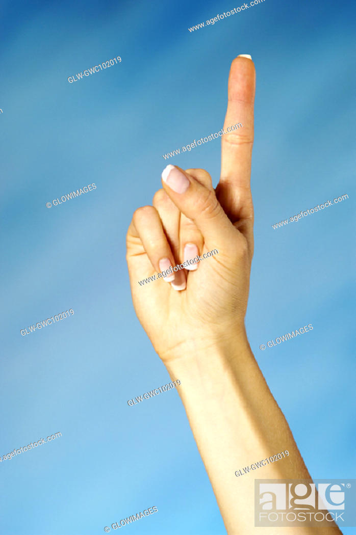 Stock Photo: Close-up of a woman holding up one finger.