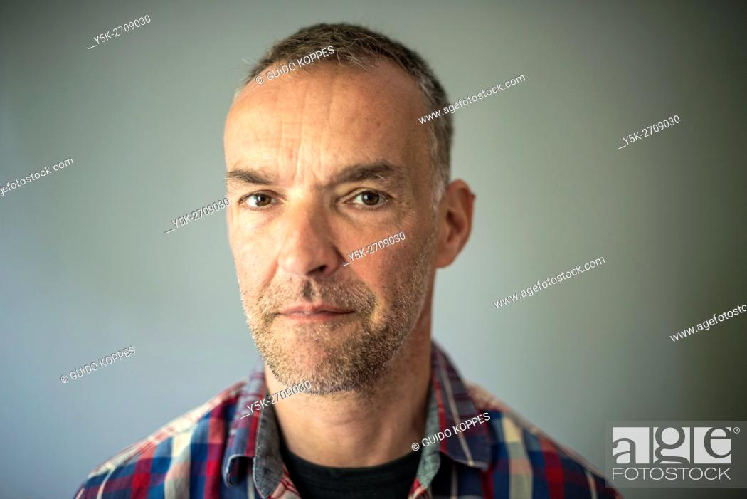Stock Photo: Tilburg, Netherlands. Portrait in Studio of a middle aged man with stuble.