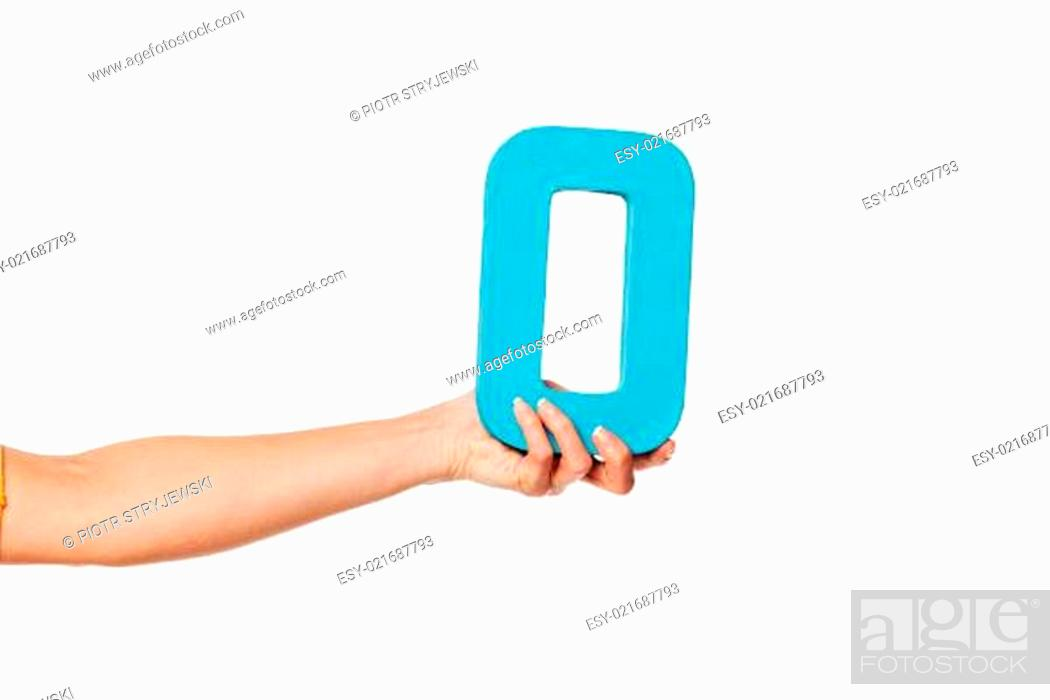 Stock Photo: hand holding up the letter O from the left.
