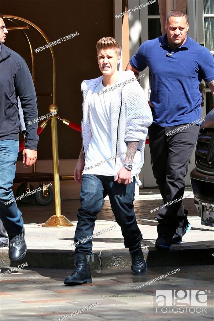 8e3e21ffea96d Justin Bieber in white net jumper, jeans and black combat boots ...