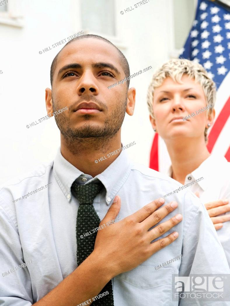 Stock Photo: People pledging allegiance in line to vote.