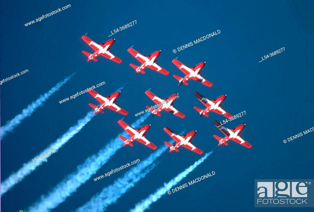 Stock Photo: Canadian Forces Snowbirds - Royal Canadian Air Force fly over Port Huron, Michigan bordering Canada.