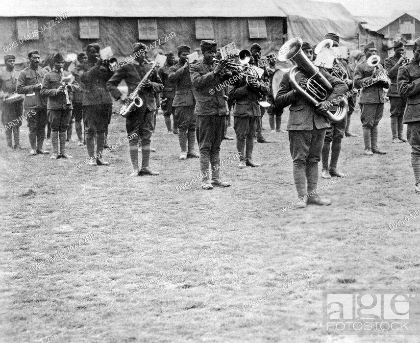 Stock Photo: France: c. 1918.Members of the 369th Infantry Regiment band under the direction of Lt. James Reese Europe. The 369th was also known as the Harlem Hellfighters.