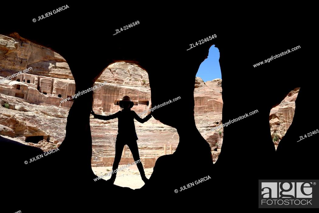 Stock Photo: Silhouette of a woman at the entrance of a cave near the theatre. Jordan (Hashemite Kingdom of), Ma'an Governorate (Maan), ancient city of Petra.