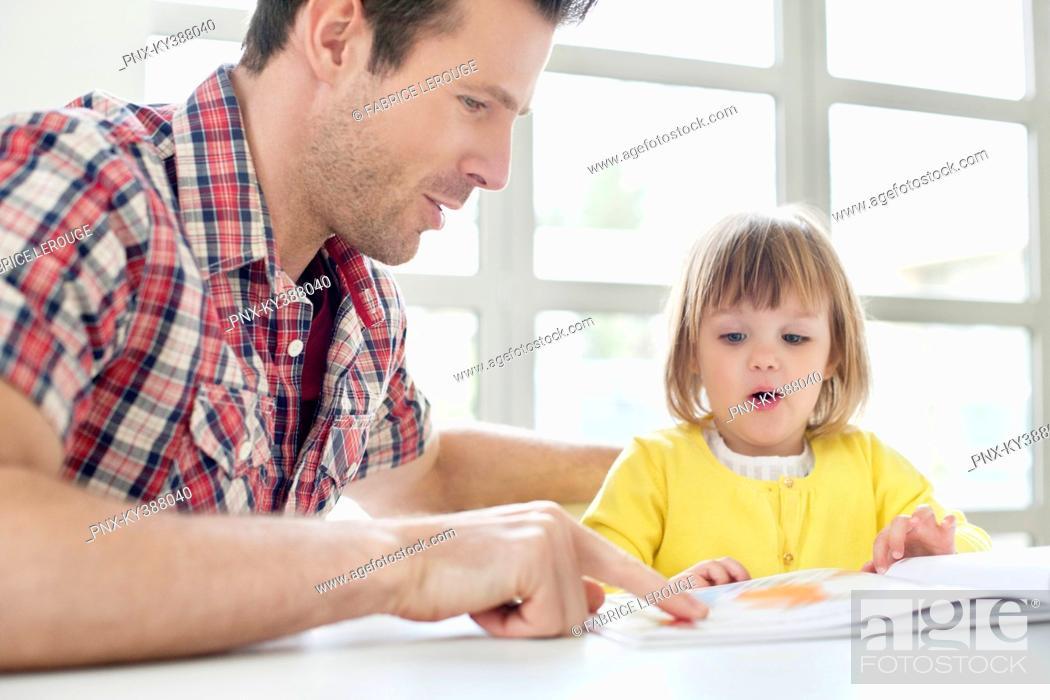 Stock Photo: Man teaching his daughter.