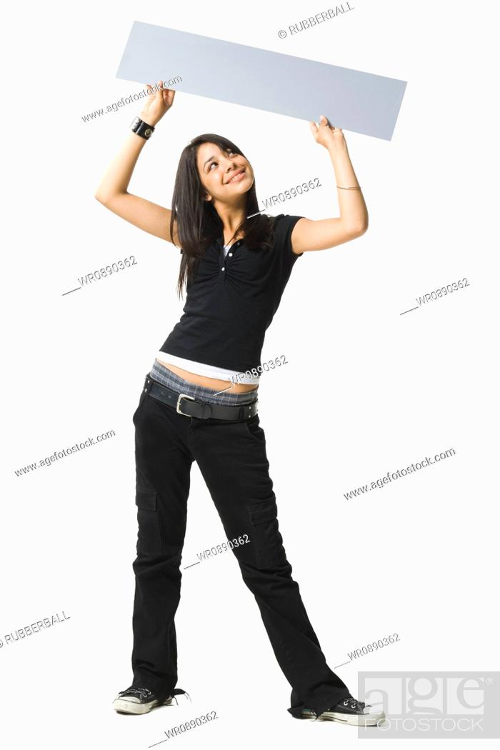 Stock Photo: Young woman holding up a blank sign.
