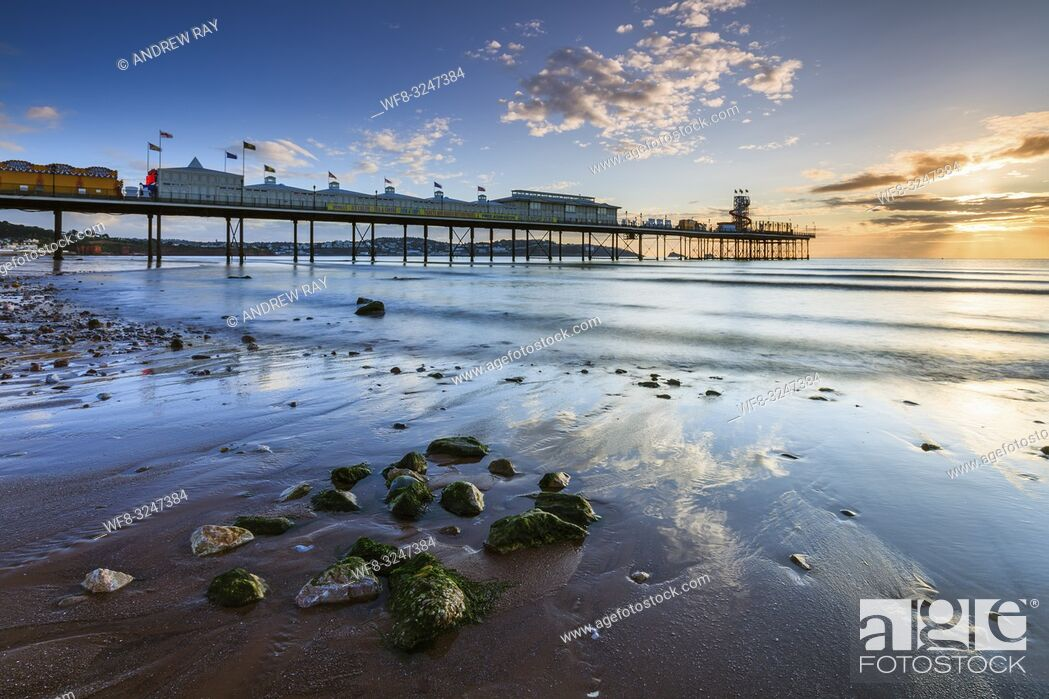 Stock Photo: Paignton Pier captured shortly after sunrise on a morning in mid September.