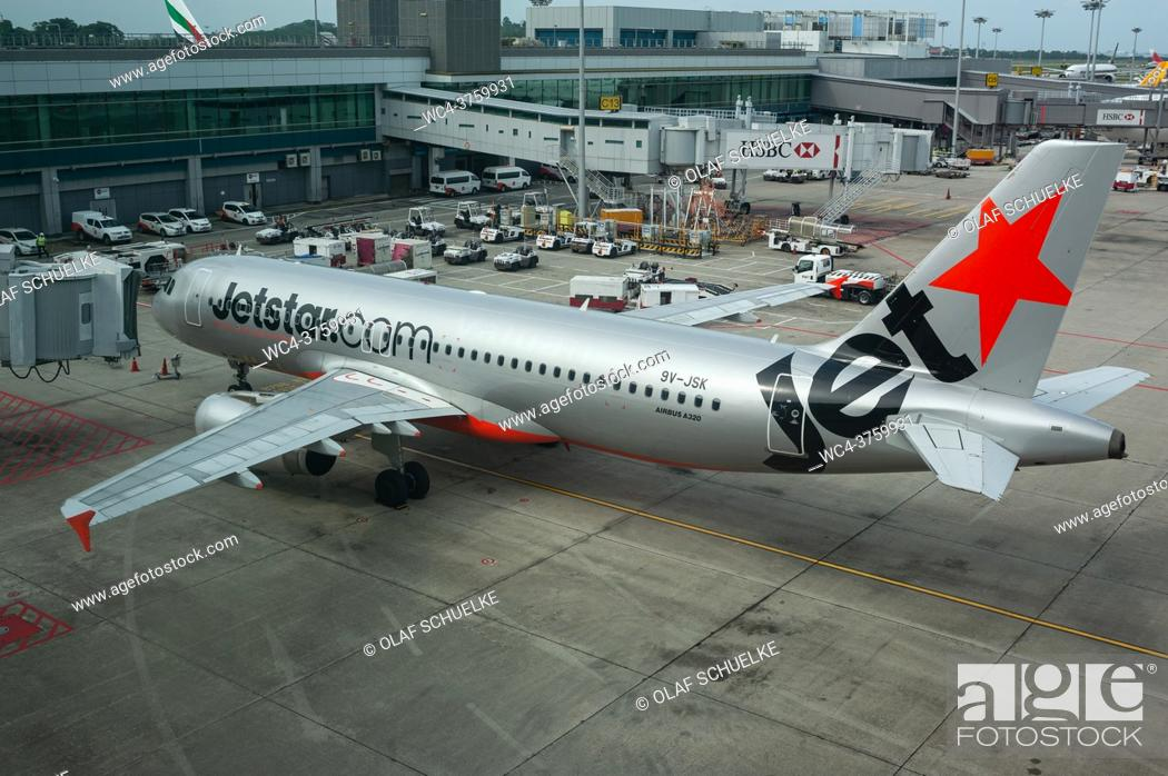 Stock Photo: Singapore, Republic of Singapore, Asia - A Jetstar Asia Airways Airbus A320-232 passenger plane with the registration 9V-JSK at Changi International Airport.