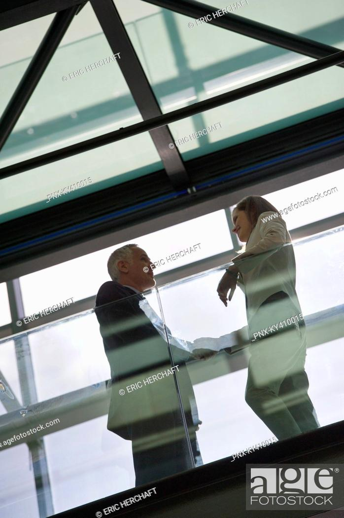 Stock Photo: Low angle view of two business executives talking.