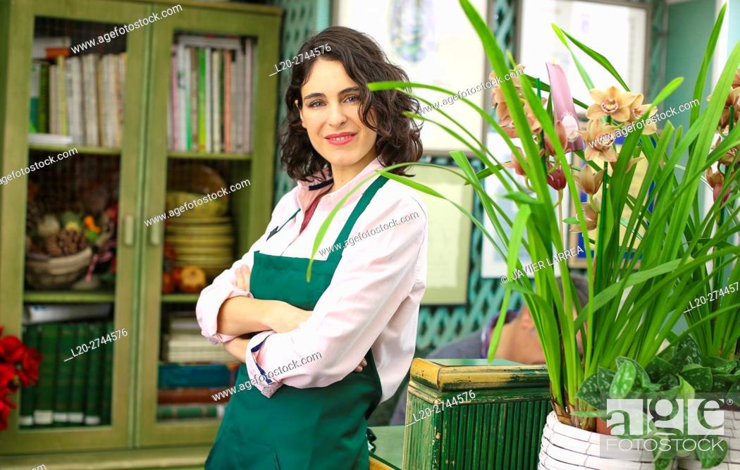 Stock Photo: Florist in flower shop.