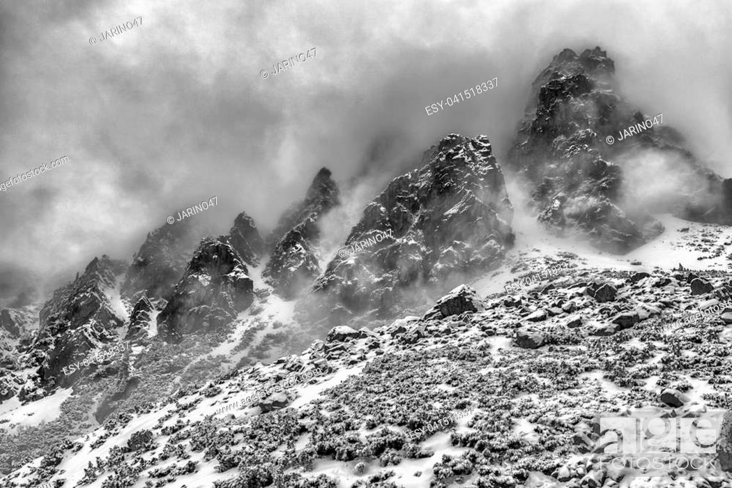 Stock Photo: Fog in top of the rocky peaks in High Tatras mountains, Slovakia.