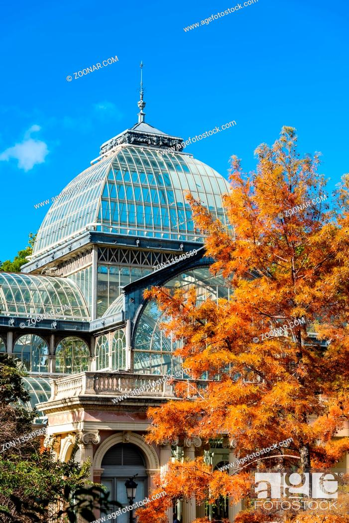 Stock Photo: Madrid, Spain - November 2, 2018: Exterior view of Crystal Palace, Palacio de Cristal, in Retiro Park. View against blue sky at autumn.