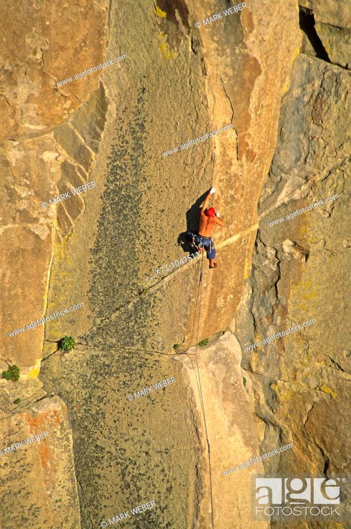 Stock Photo: Man rock climbing a route called Strategic Defense which is rated 5,11 and located on Morning Glory Spire at The City Of Rocks National Reserve in southern.