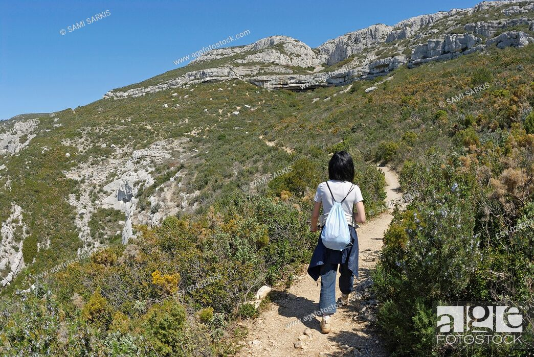 Stock Photo: Woman hiking in the Sainte-Baume Mountains, Provence, France, Europe.