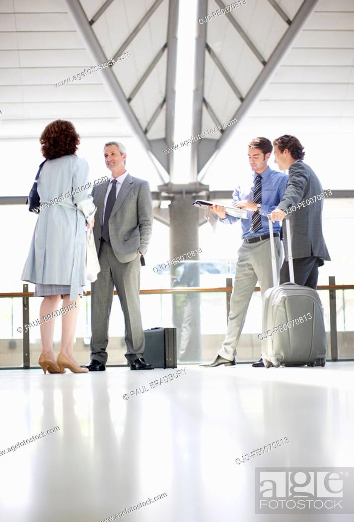 Stock Photo: Business people waiting in train station.
