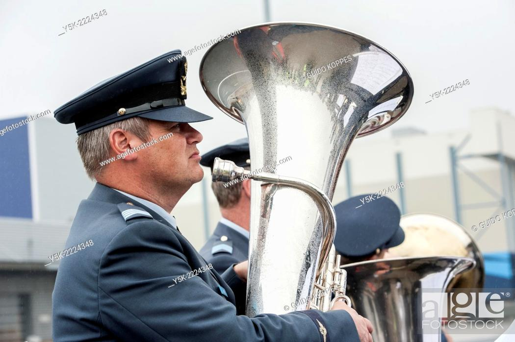 Stock Photo: Eindhoven Airbase, Eindhoven, Netherlands. Musician of a military band playing the tuba during a ceremony at returning personnel from Afghanistan.