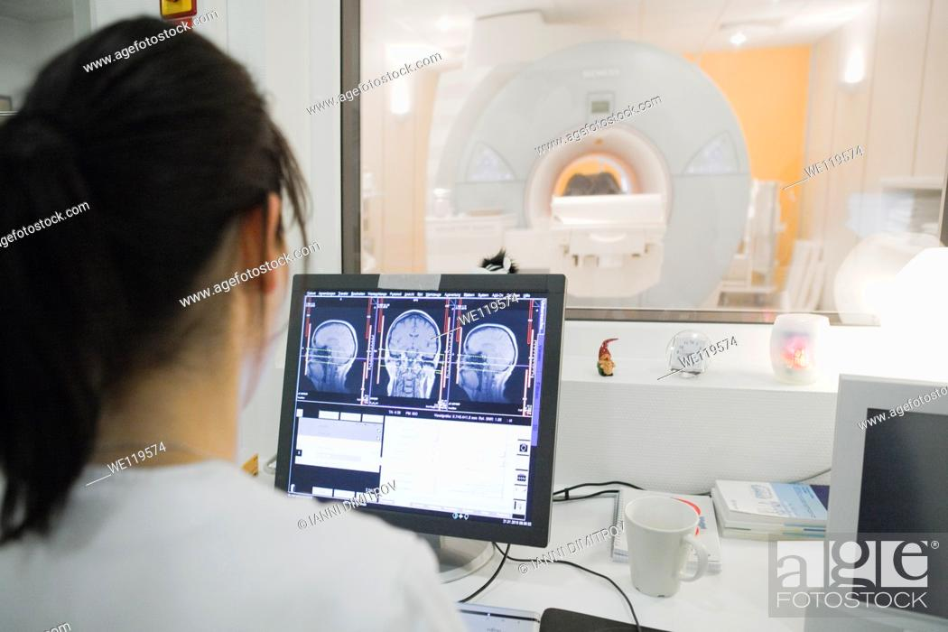 Stock Photo: Female radiologist at work.