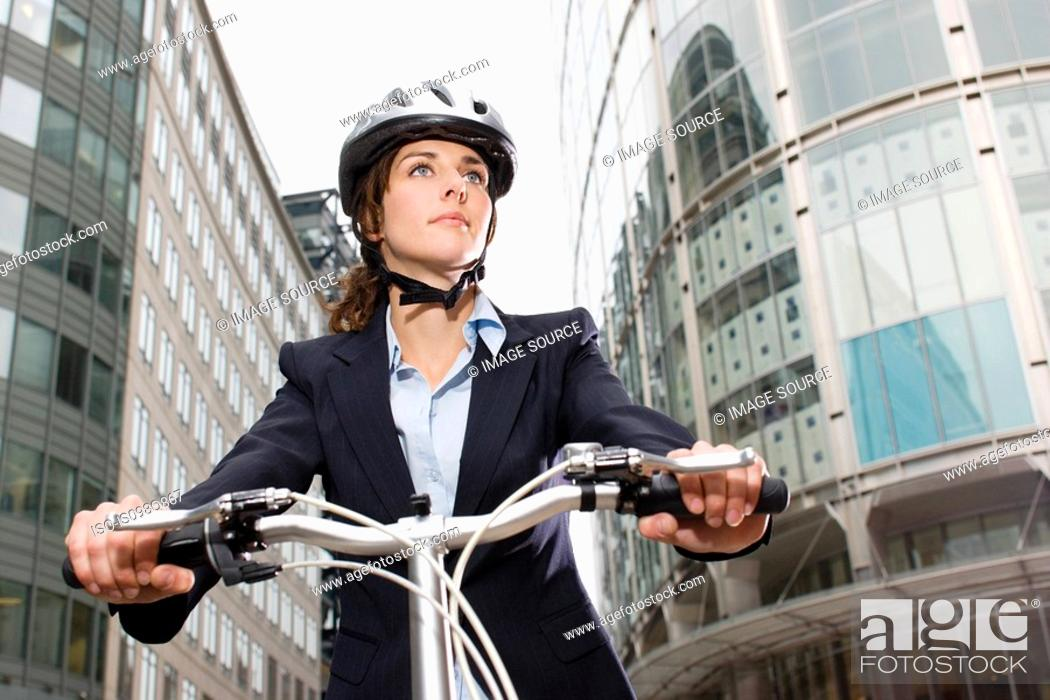 Stock Photo: Woman cycling in city.