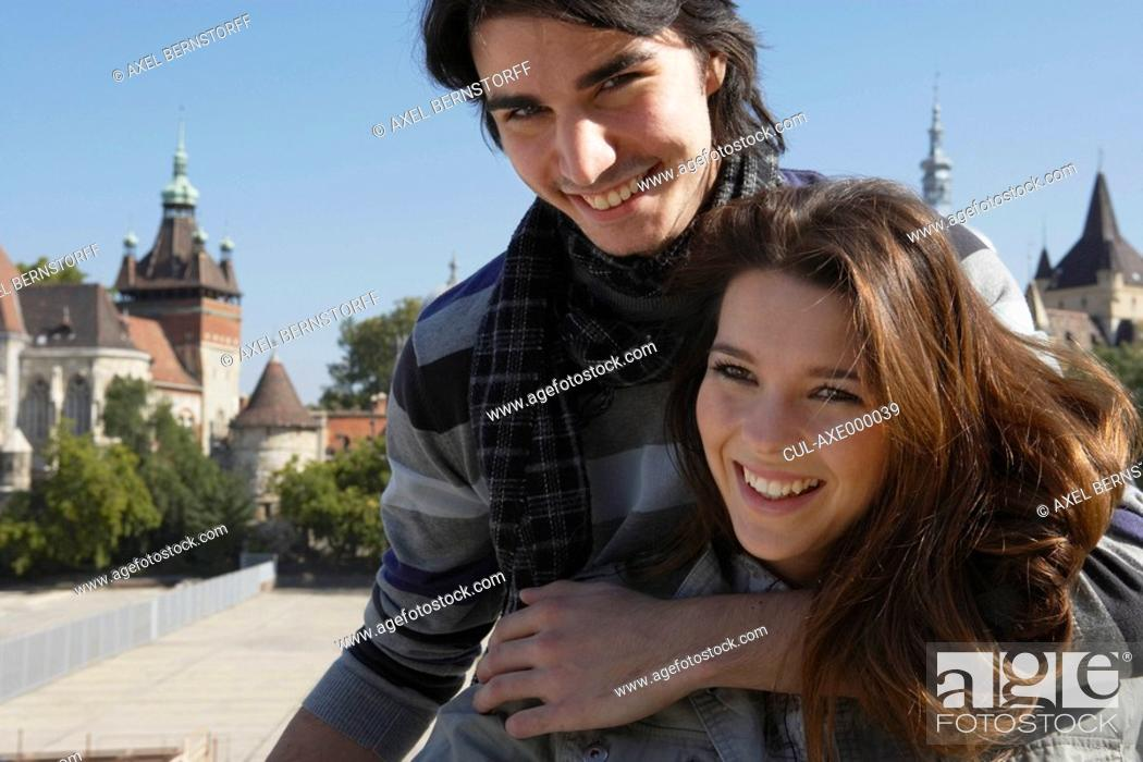 Stock Photo: Couple embracing outdoors smiling.