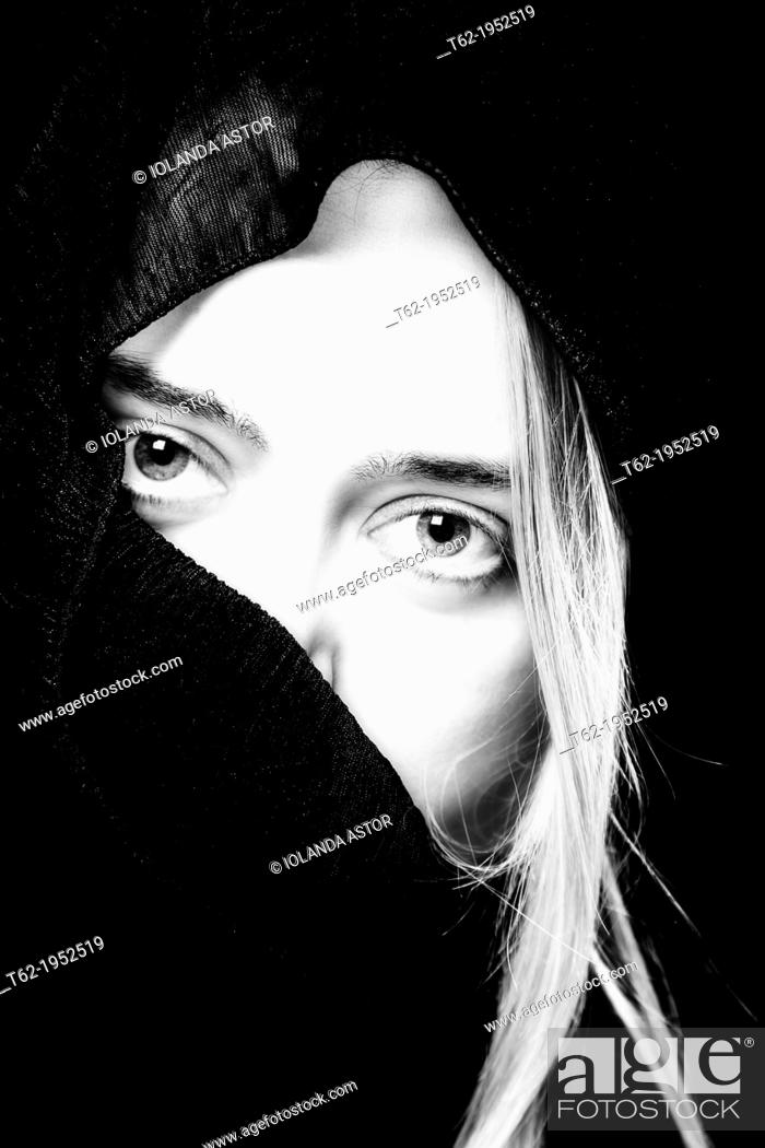 Stock Photo: Close up of the face of a white woman with headscarf.