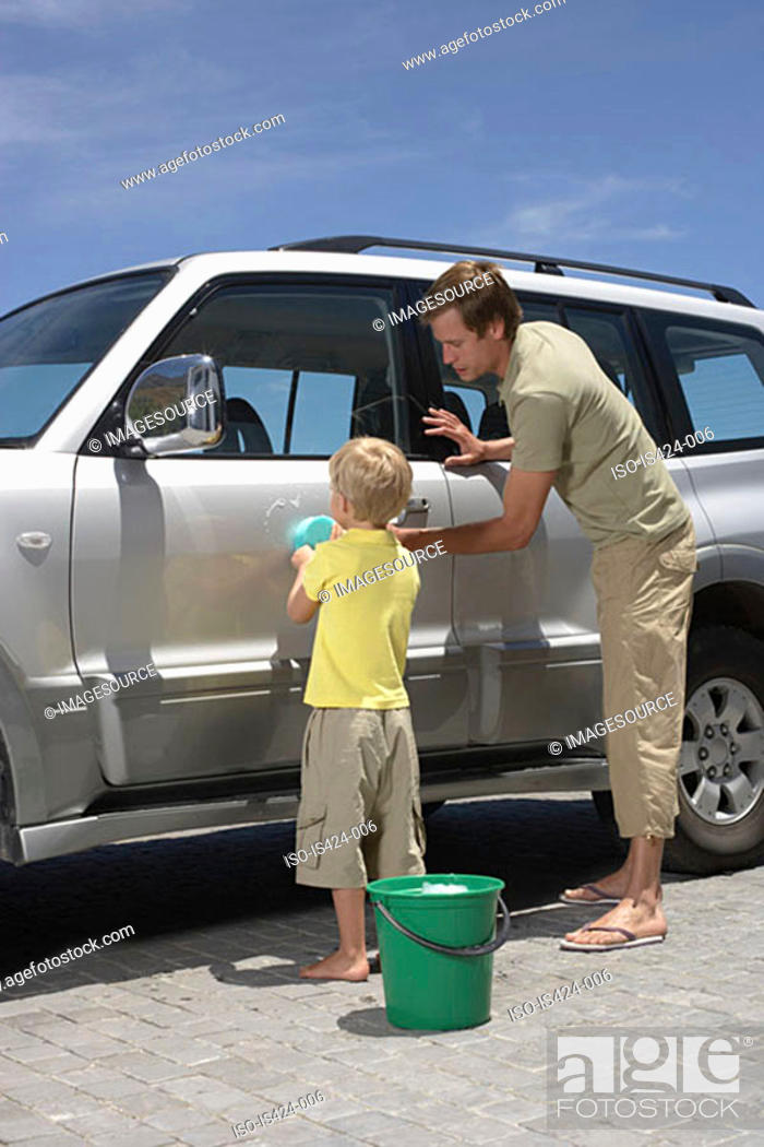 Stock Photo: Father and son washing the car.