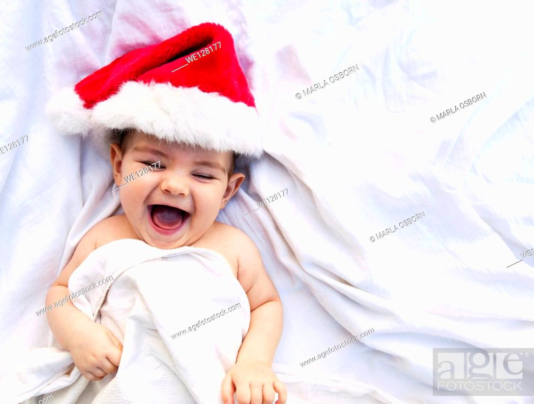 Stock Photo: Happy baby in a Santa hat.