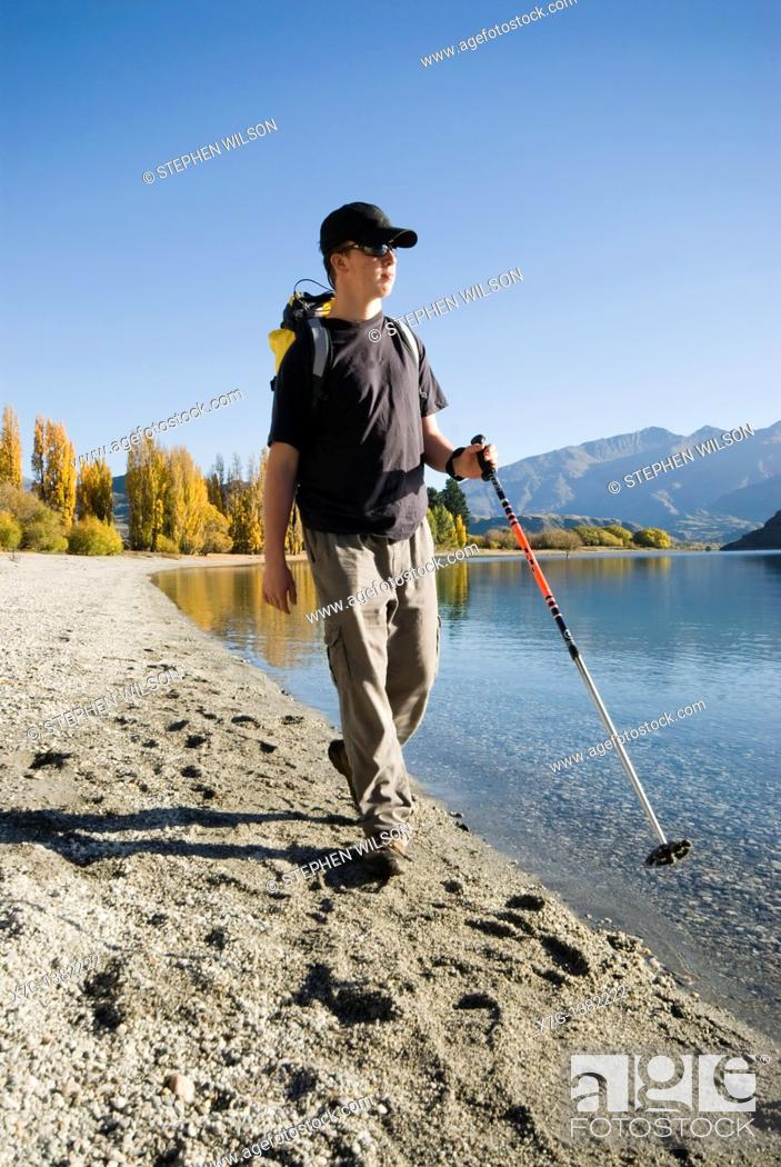 Stock Photo: Young hiker walking at Glendhu Bay on the shores of Lake Wanaka, South Island of New Zealand.