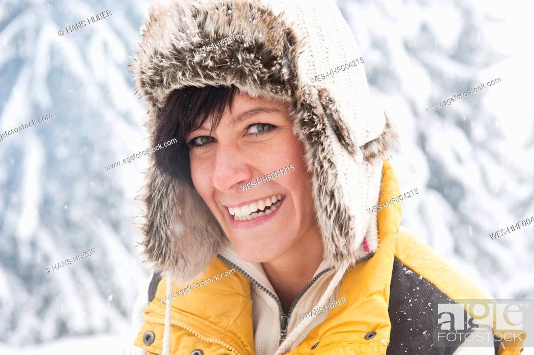 Stock Photo: Austria, Salzburg, Young woman smiling, portrait.