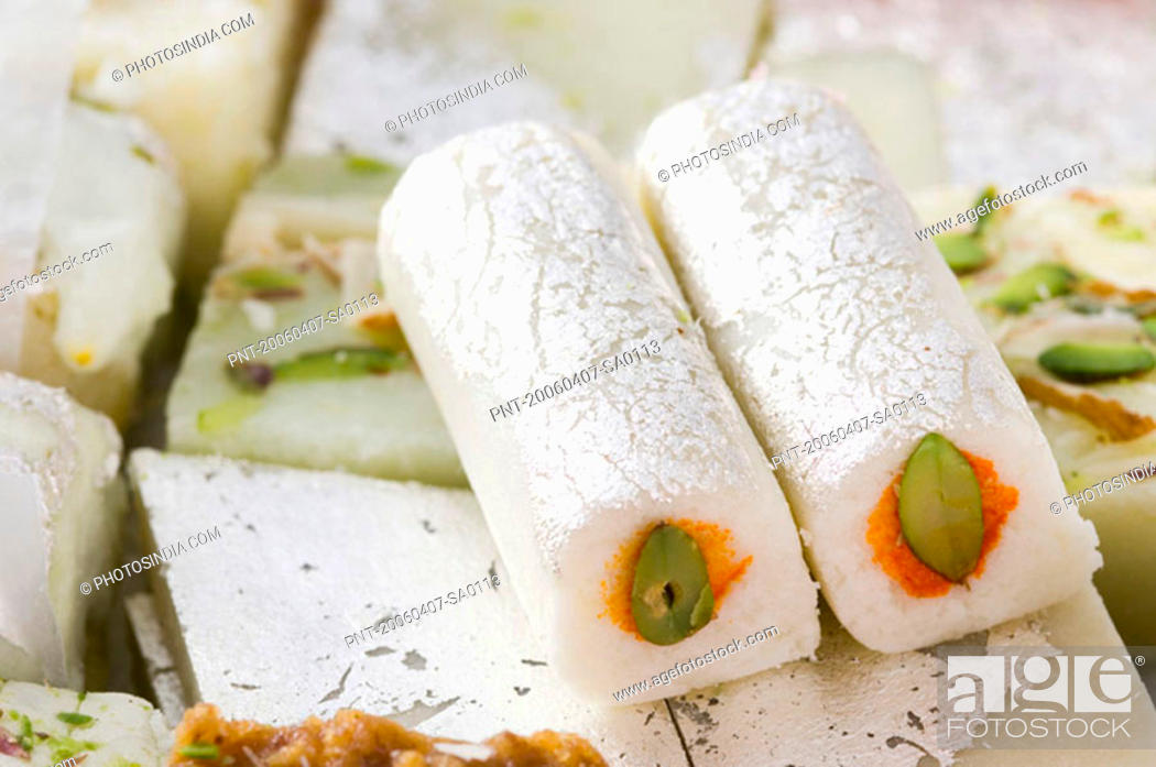 Stock Photo: Close-up of Kaju roll with Kaju Katli.