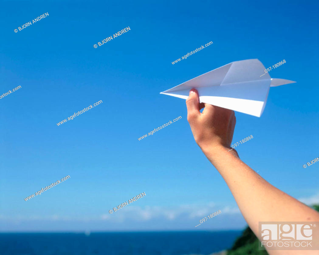 Stock Photo: Hand with paper plane.