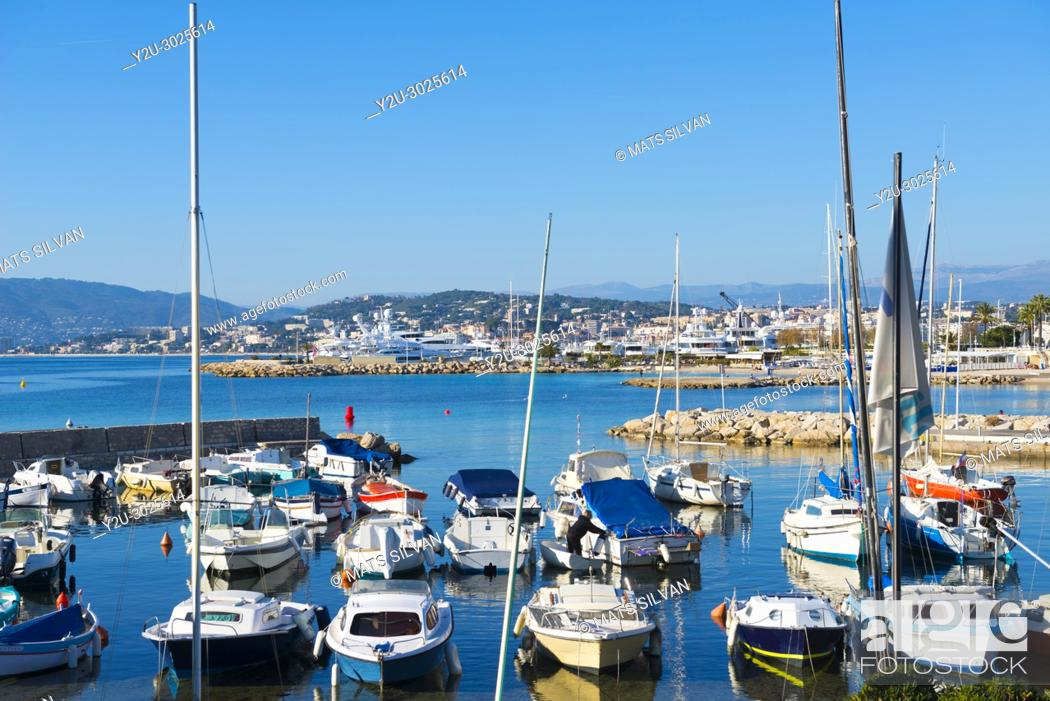 Stock Photo: Port With Nautical Vessel on Mediterranean Sea in a Sunny Day in Cannes in Provence-Alpes-Côte d'Azur, France.