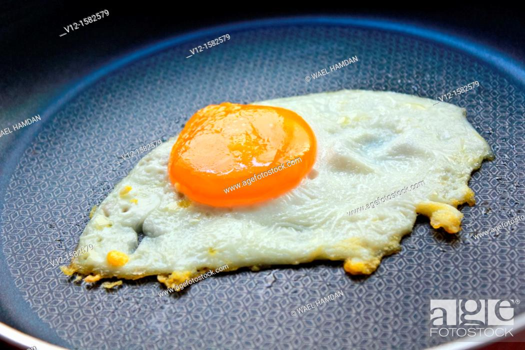 Stock Photo: Egg yolk in a fryer.
