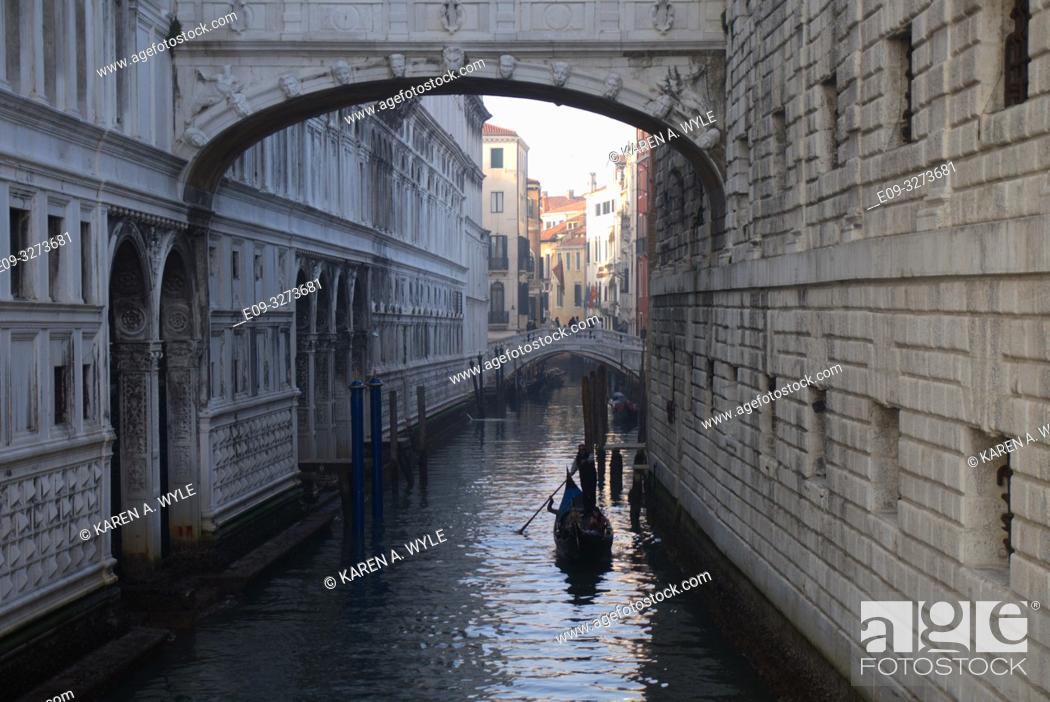 Stock Photo: view of Rio di Palazzo under Bridge of Sighs, another bridge in background, gondola on canal, Venice, Italy.