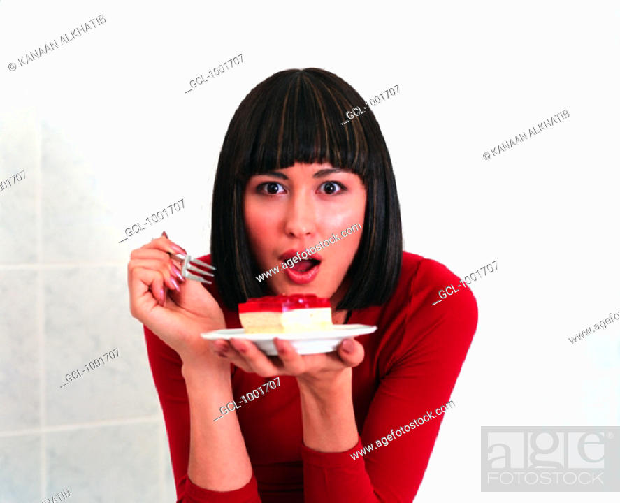 Stock Photo: Woman eating a piece of cake.