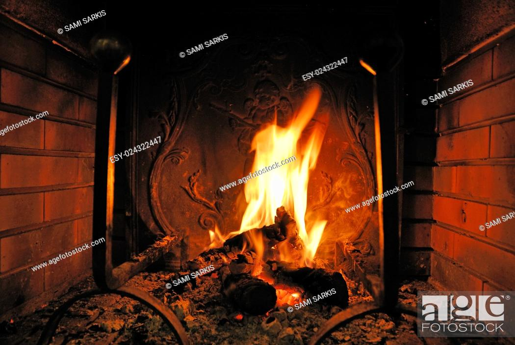 Stock Photo: Log fire burning in a fireplace.