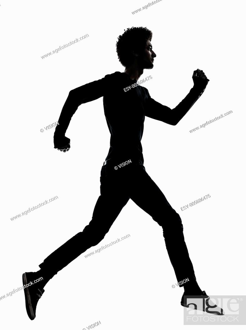 Stock Photo: one african handsome young man running in silhouette studio isolated on white background.