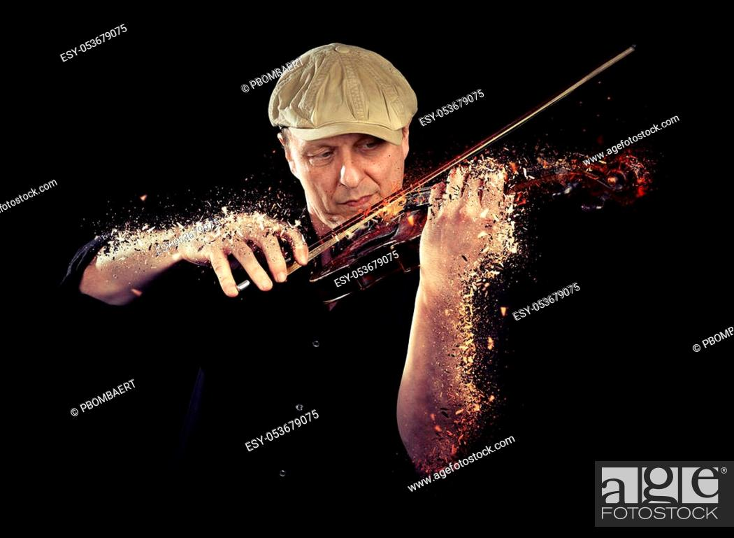 Stock Photo: Portrait of a man playing wooden violin shattering on black background.