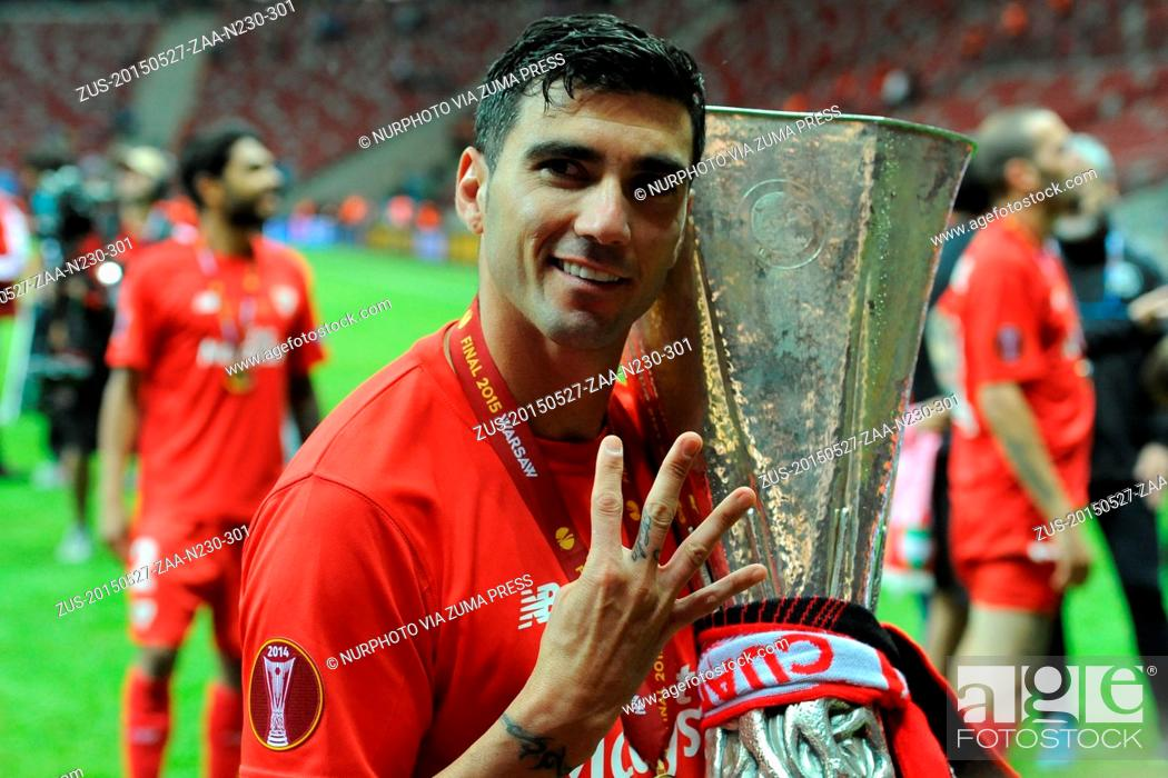Stock Photo: May 27, 2015 - Naples, Italy - Sevilla Jose Antonio Reyes celebrate with the trophy at the end of the UEFA Europa league final football match between FC Dnipro.