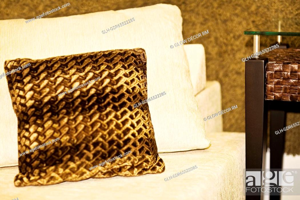 Photo de stock: Cushion on a couch.