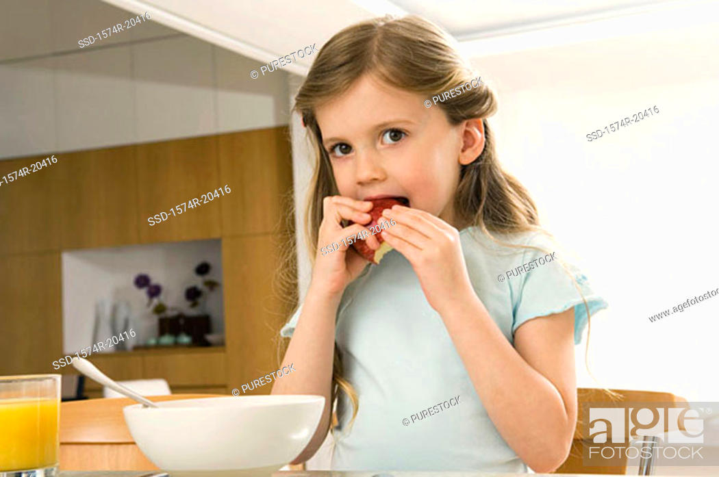Stock Photo: Portrait of a girl eating an apple.