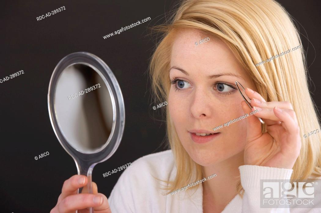 Woman Is Picking The Eyebrows Stock Photo Picture And Rights