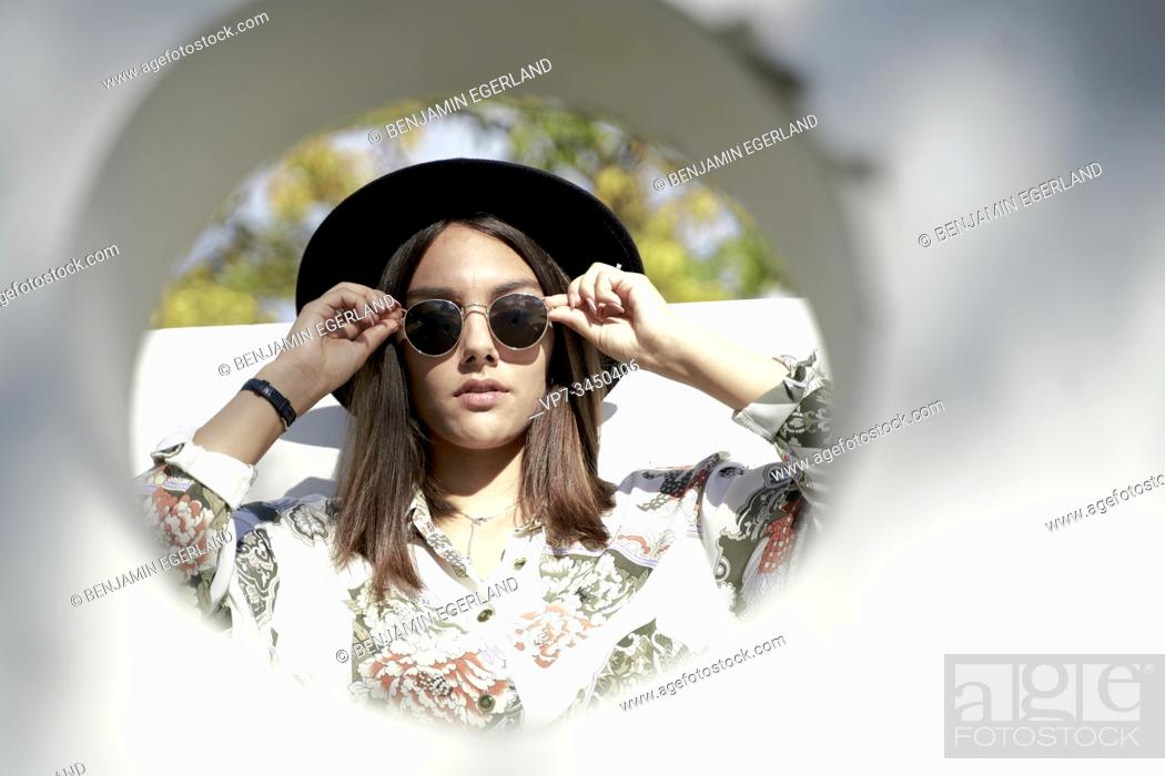 Stock Photo: Portrait of woman wearing hat.